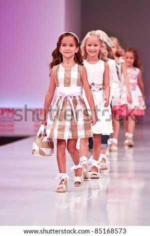 MOSCOW - SEPTEMBER 7: Collection of clothing Special Day at the international exhibition of  the fashion industry, Collection Premiere Moscow, CPM on September 7, 2011 in Moscow. Unidentified children - stock photo