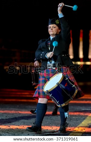 "MOSCOW - SEPTEMBER 10, 2015: international festival of military orchestra ""Spasskaya tower"", bagpipes orchestra and drums band ""United by music"" and dance School ""Shady Glen"", Ireland. Russia."