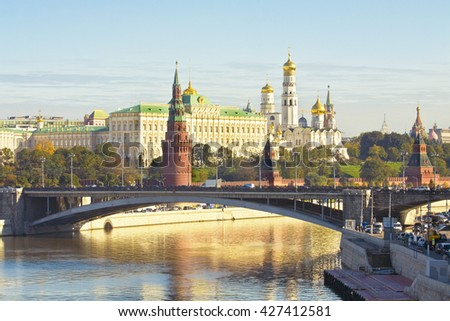 MOSCOW - SEPTEMBER 27, 2013: Kremlin fortress with palace and cathedrals and Big Stone bridge on Moscow-river in Moscow, Russia. - stock photo