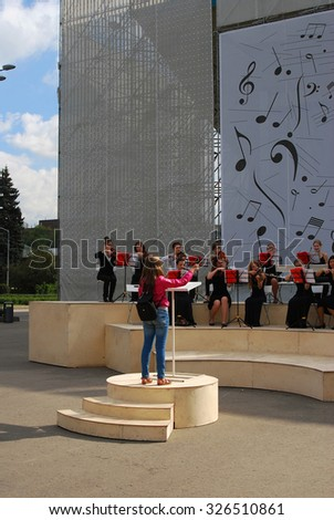 MOSCOW - SEPTEMBER 06, 2014: Orchestra plays in the Gorky park. Moscow City Day celebration in Moscow city center.