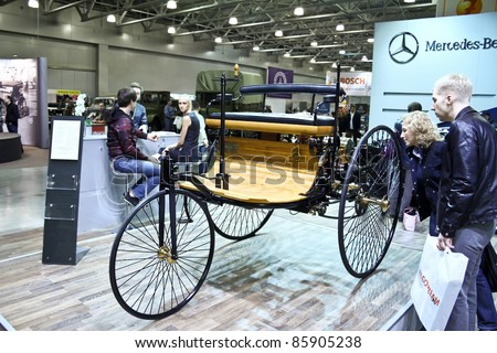 MOSCOW - SEPTEMBER 16: People are interested Benz Patent Motorwagen (motorcar) 1886 at the international exhibition of the technical antiques on September 16, 2011 in Moscow, Russia - stock photo