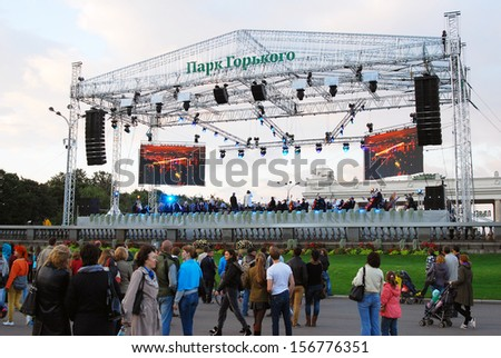 MOSCOW - SEPTEMBER 07: People walk and stand by a concert stage. Day of the City celebration in the Gorky recreation park in Moscow. Taken on September 07, 2013 in Moscow.