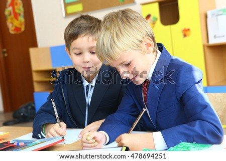 MOSCOW, SEPTEMBER 1, 2016: Unidentified boys on solemn  September 1 day  of first grade kids, called the Day of Knowledge for pupils, signify the beginning of school year in Moscow, September 1, 2016