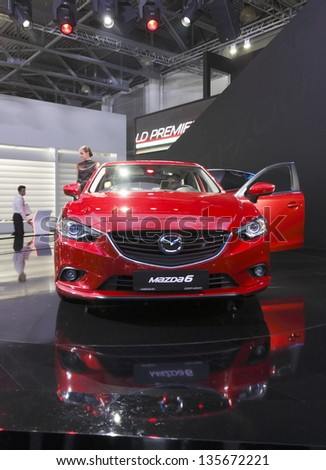 MOSCOW-SEPTEMBER 3:World premiere of the Mazda 6 at the Moscow International Motor Show on September 3, 2012 in Moscow, Russia. - stock photo