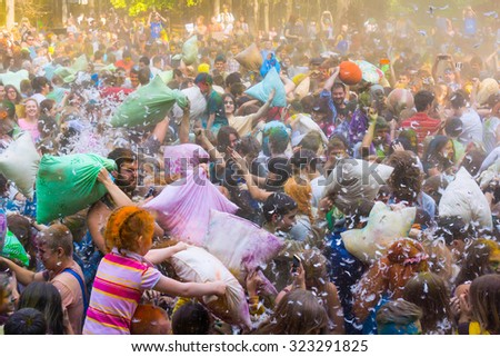 MOSCOW - SEPTEMBER, 27: Young people are fighting pillows at event Big Pillows Battle and Holi paints festival on September 27, 2015 in Moscow - stock photo