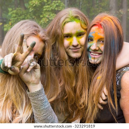 MOSCOW - SEPTEMBER, 27: Young people having fun at the event Big Pillows Battle and Holi paints festival on September 27, 2015 in Moscow - stock photo