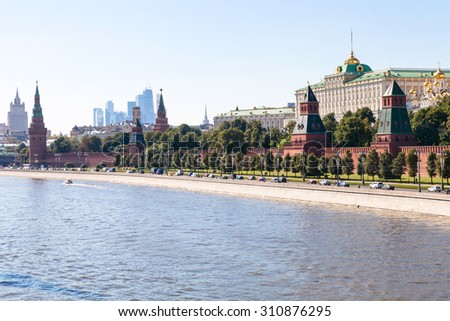 Moscow skyline - view of The Kremlin embankment, Kremlin buildings, walls, towers, Moscow City in summer afternoon - stock photo