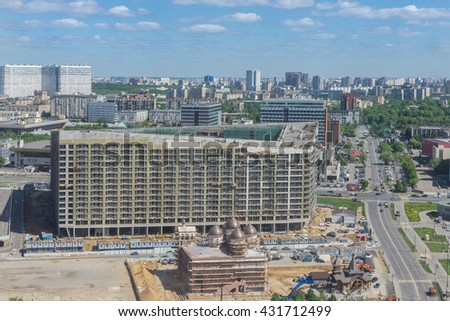 MOSCOW,  2016: View from the heights of the district Khodynka field in Moscow. Construction of a church of St. Sergius of Radonezh
