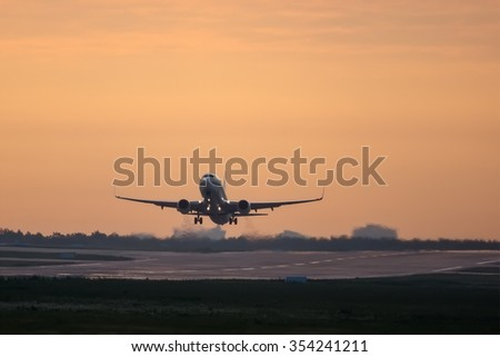 Moscow - Vnukovo, Russia - July 05, 2014: Boeing 737 UTair aviation taked off at sunrise at the Moscow Vnukovo International airport.