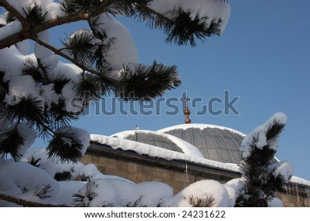 Mosque after a snowfall - stock photo
