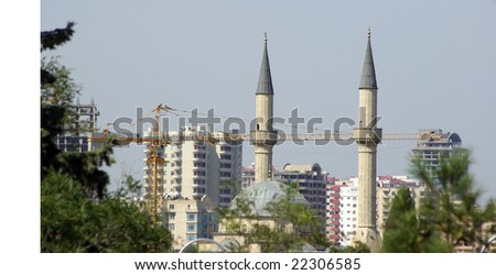 Mosque and the crane - stock photo