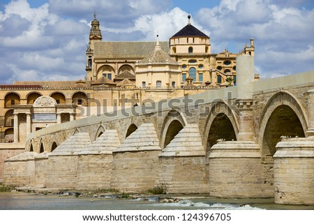 Mosque Cathedral (La Mezquita) and Roman Bridge on Guadalquivir river in Cordoba, Spain, Andalusia region. - stock photo