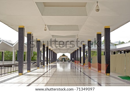 Mosque corridor covered with bright and white tiles in Kuala Lumpur, Malaysia, Asia. - stock photo