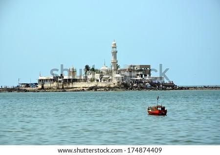 Mosque Haji Ali in Mumbai; Mosque was built in 1431 in memory of a rich Muslim merchant - stock photo