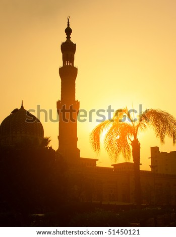 Mosque in Cairo over sunset light - stock photo