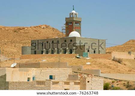 Mosque in construction with Arab style minaret in the desert oasis in Tunisia