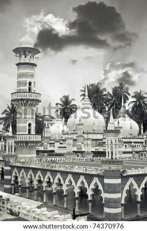 Mosque scenery with famous KL landmark, Masjid Jamek, in Kuala Lumpur, Malaysia, Asia. - stock photo