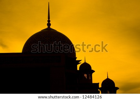 mosque silhouette during sunset - stock photo