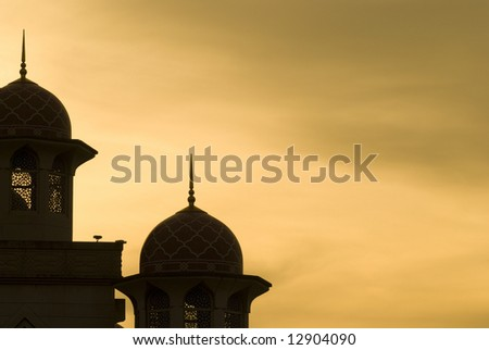 mosque silhouette during sunset for background purpose - stock photo