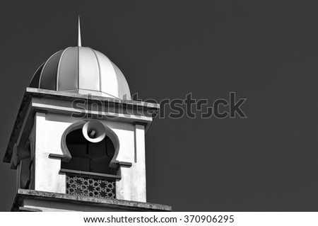 Mosque Tower With Morning Blue Sky With Copy Space Area  in black and white.