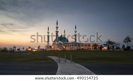 mosque with green dome during sunset