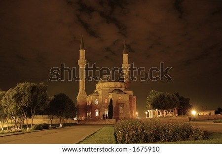 Mosque with two minarets in Baku, Azerbaijan at sunset - stock photo