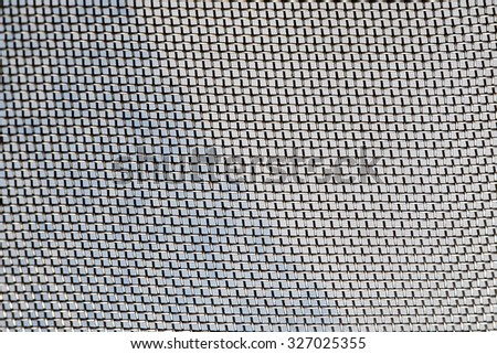 Mosquito wire screen texture on the window - stock photo