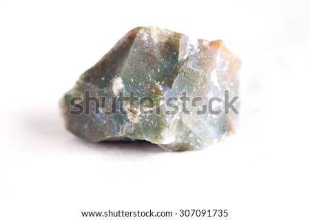 moss agate crystal mineral sample used as a healing stone - stock photo