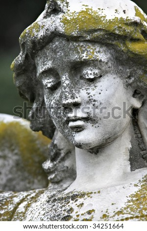 Moss covered statue - stock photo
