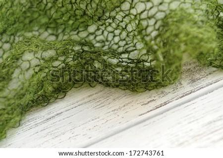 Moss green knit frame - stock photo