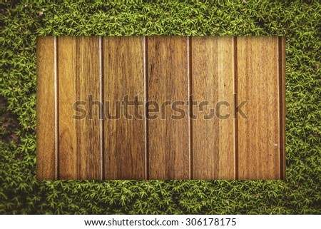 moss rectangle border on wood