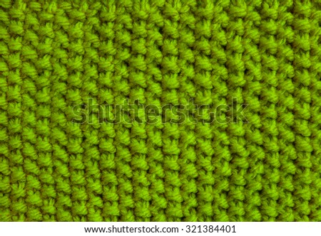 Moss stitch knitting in green yarn as an abstract background texture - stock photo