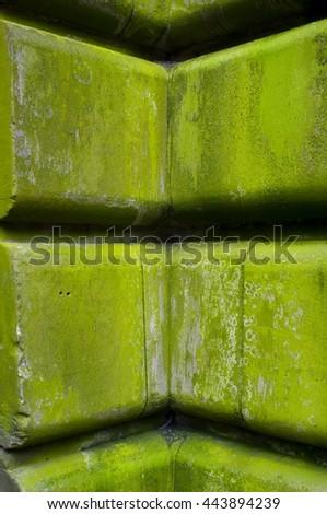 mossy stone facade - stock photo