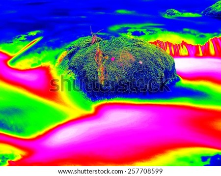 Mossy stone in cold mountain stream.. Boulders and water level.  Infrared scan of photo. Amazing thermography - stock photo