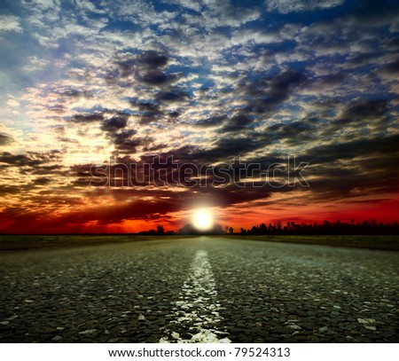 Most asphalt road. Shallow depth of field - stock photo