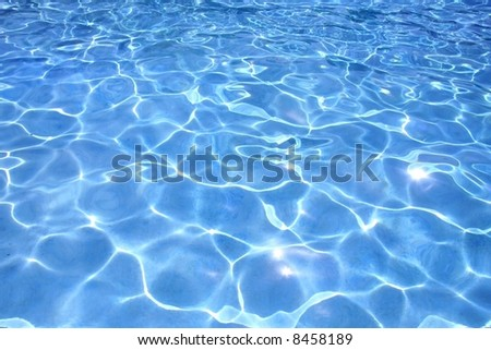 Most beautiful clear pool water reflecting in the sun - stock photo