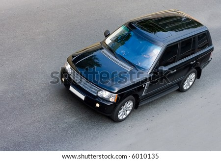 most luxurious brand of british suv drive on road isolated. See many similar quality images in my portfolio - stock photo