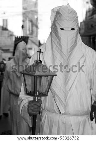 MOSTA, MALTA - APR 02: Hooded men in white habits during the Mosta Good Friday procession in Malta April 02, 2010 - stock photo