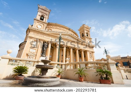 MOSTA, MALTA - AUGUST 31: The Church of the Assumption of Our Lady, commonly known as the Rotunda of Mosta or The Mosta Dome on August 31, 2013. It is a Roman Catholic church in Mosta, Malta - stock photo