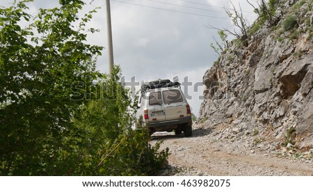 MOSTAR, BOSNIA AND HERZEGOVINA - CIRCA JUNE 2016:  off road cars on a track in the mountains nearby the village of Mostar.
