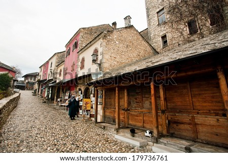 MOSTAR, BOSNIA AND HERZEGOVINA - DEC 28: Group of women walk around a touristic street of the historical city on December 28, 2013. Old Mostar is inscribed on World Heritage List by UNESCO in 2005 - stock photo