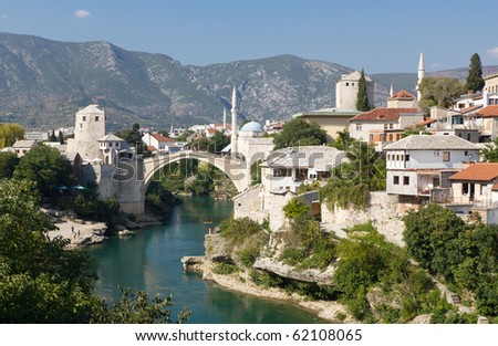 MOSTAR, BOSNIA AND HERZEGOVINA- SEPTEMBER 24: Tourists Walking Across the Historic Old Bridge On September 24, 2010 in Mostar, Bosnia and Herzegovina - stock photo