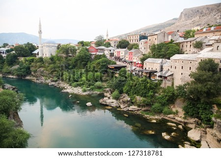 MOSTAR, BOSNIA - AUGUST 9: View of old town from Stari Most bridge on August 9, 2012 in Mostar, Bosnia. This old town founded in 1452, was mostly destroyed during the Bosnian war from 1991 to 1995. - stock photo