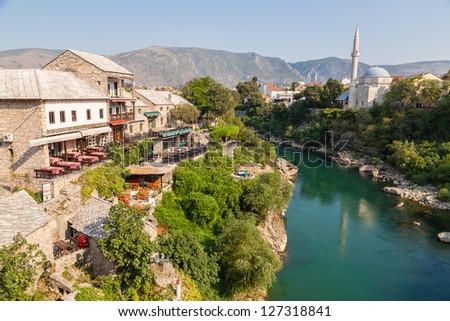 MOSTAR, BOSNIA - AUGUST 10: View of old town from Stari Most bridge on August 10, 2012 in Mostar, Bosnia. This old town founded in 1452, was mostly destroyed during the Bosnian war from 1991 to 1995. - stock photo