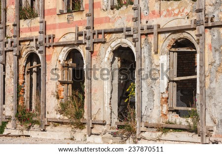 MOSTAR, BOSNIA-HERZEGOVINA - OCTOBER 24, 2014: the remains of Hotel Neretva. The signs of the Yugoslavian wars are still visible on many buildings in Mostar. - stock photo