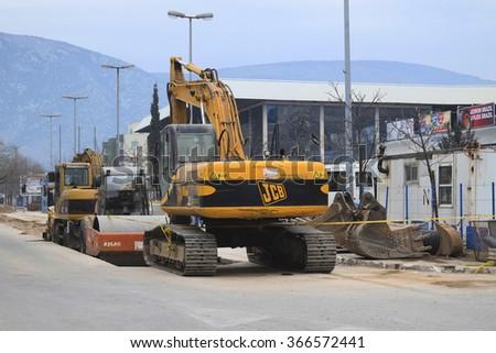 Mostar, Bosnia, January, 1, 2016: the heavy machinery works on construction in Mostar, Bosnia - stock photo