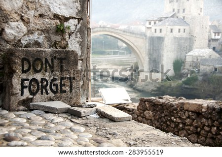 """Mostar Bridge vie with """"Don't Forget"""" text. - stock photo"""