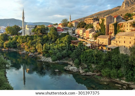 Mostar city in Bosnia and Herzegovina seen from the famous bridge. - stock photo
