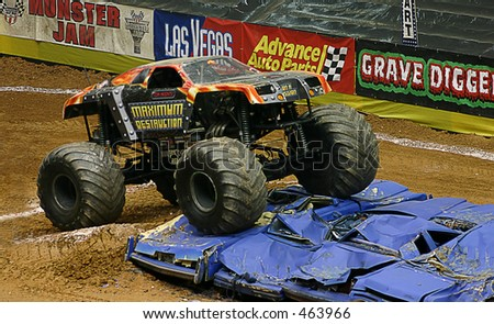 moster truck jumping cars - stock photo