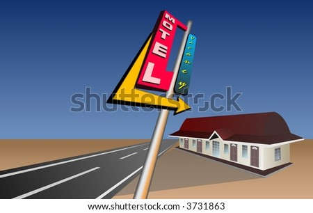 Motel bill board on road side pointing to Motel